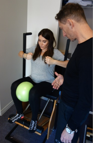 Pregnant knee ball chair Pilates