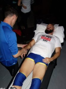 Damian works on wrestler, Jim Nye the Science Guy