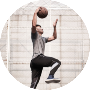 a boy jumping with a basketball
