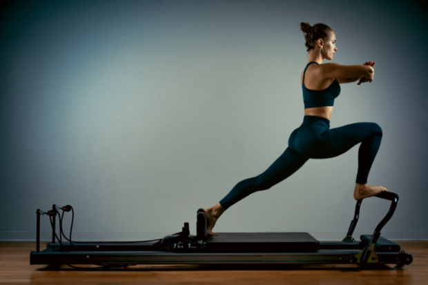 a woman lunging on a machine