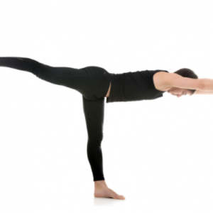 person wearing all black in a warrior pose